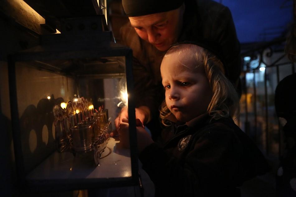 Hanukkah in Mea Shearim Jerusalem by Agnieszka Traczewska. Courtesy of the artist.